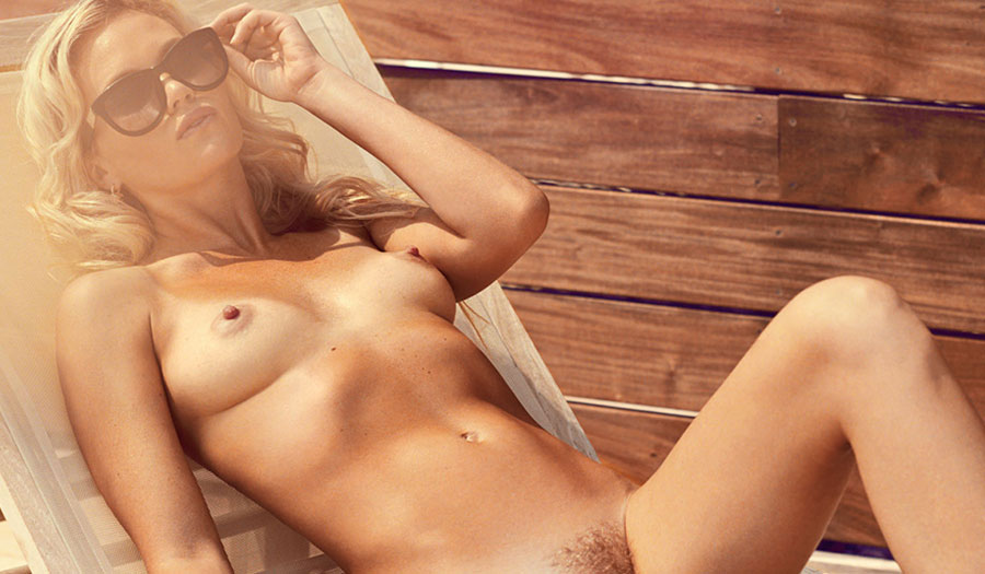 Lindsay Jones nude for Playboy, lounging naked on a Brooklyn rooftop.