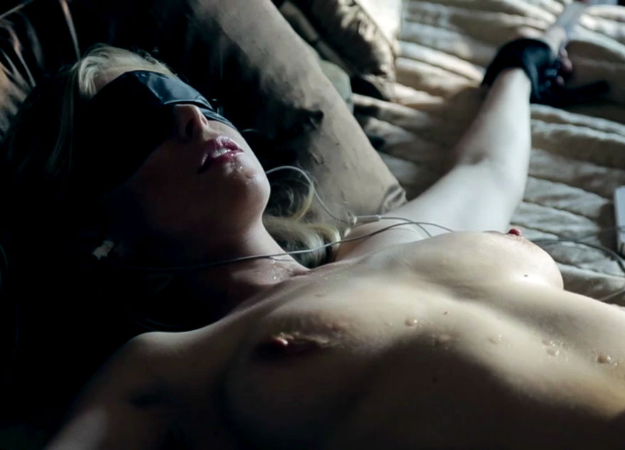 The Submission of Emma Marx. Penny Pax nude, blindfolded and cuffed in a bondage video, a shades of grey porn version.