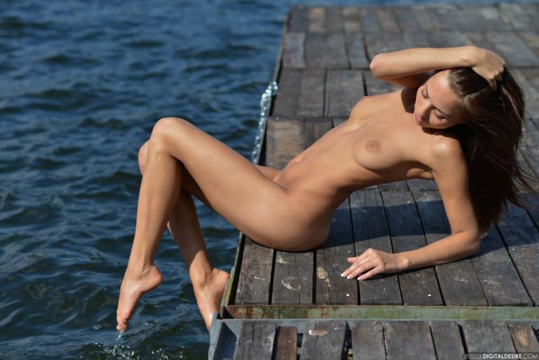 Long-legged and lecherous: Michaela Isizzu flashing nude at the dock. Shot for Digital Desire