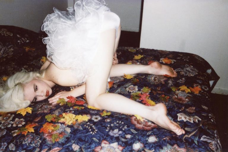Girl on a bed. Photograph by Limir Smath.