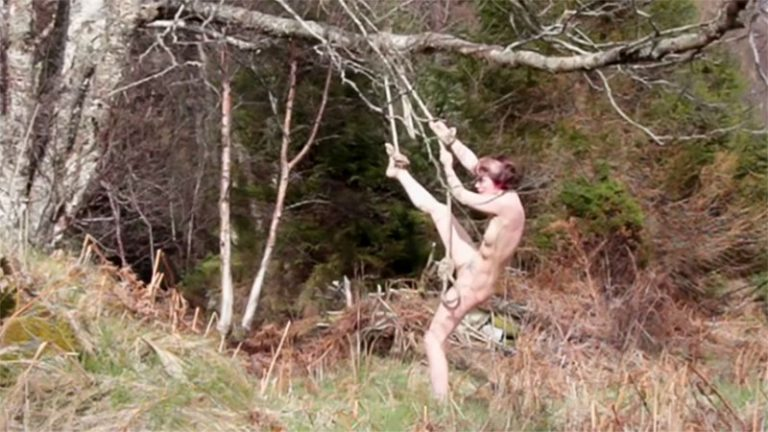 A nude girl stuck and tied to a tree films herself and becomes a piece of video art. Hilde Krohne Huse on youtube.