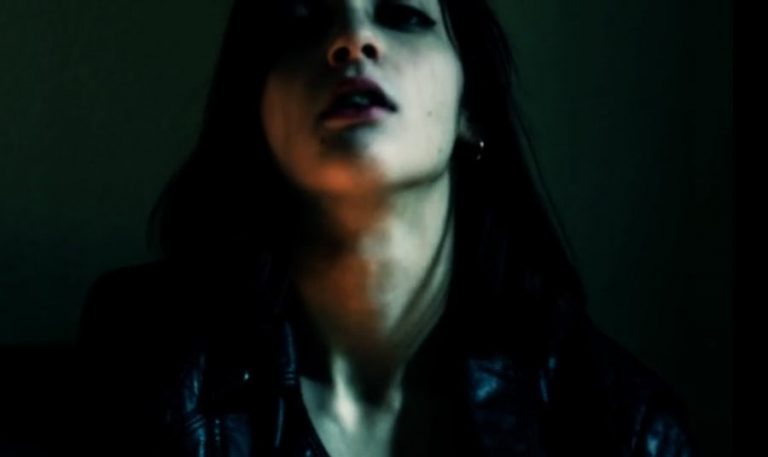 Still from the video Femme Noir by Nico Bertrand featuring Margou Darko.