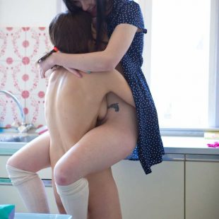 Kissing  and nibbling nude in the kitchen. A photoset from AbbyWinters.