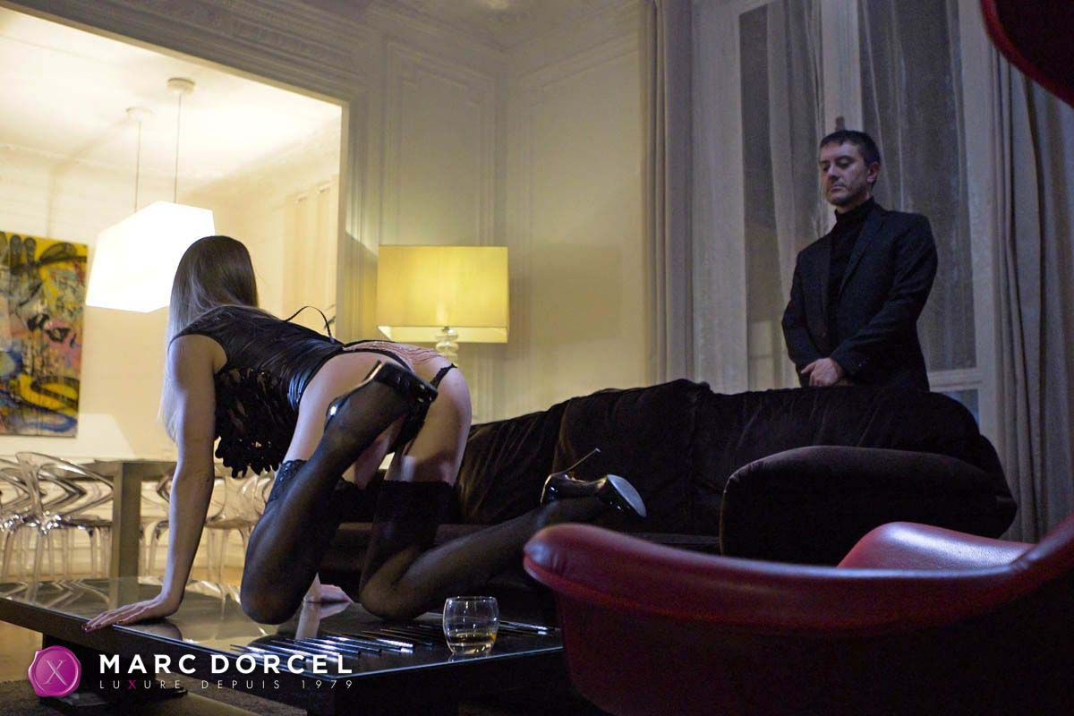 Claire Castel, nude in public, forced to sex in the BDSM video Desires of Submission by Marc Dorcel.