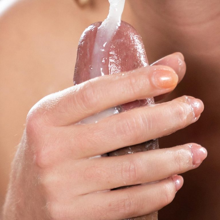 Alexis Crystal's Cummy Handjob. An uncensored Cum Fetish video with a nude girl sucking and stroking cocks by Bukkake studio SpermMania.