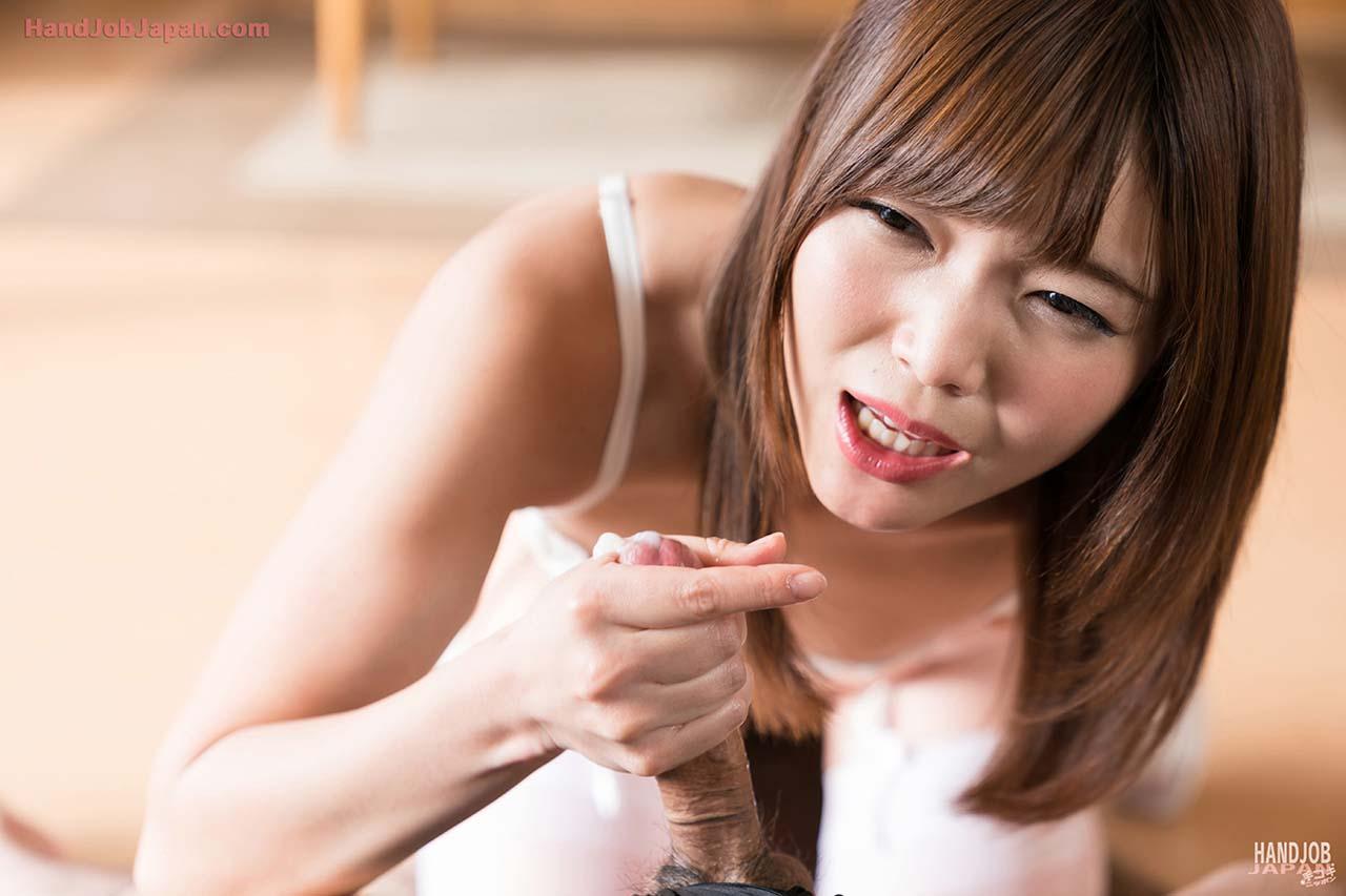 Handjob. Shino Aoi masturbates and strokes cock in an uncensored video from HandjobJapan.